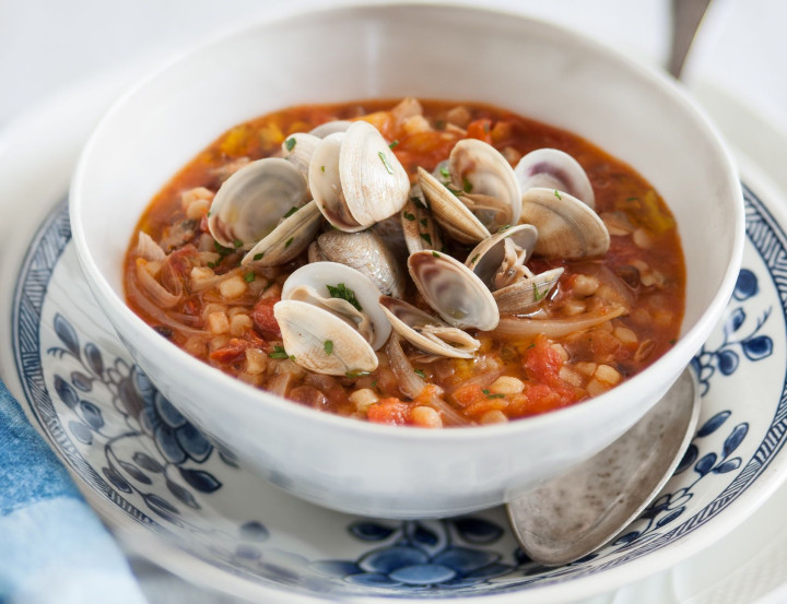 Fregula with clams and cherry tomatoes