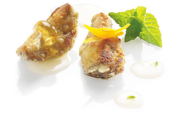 Fried artichokes with honey and fine herbs vinegar
