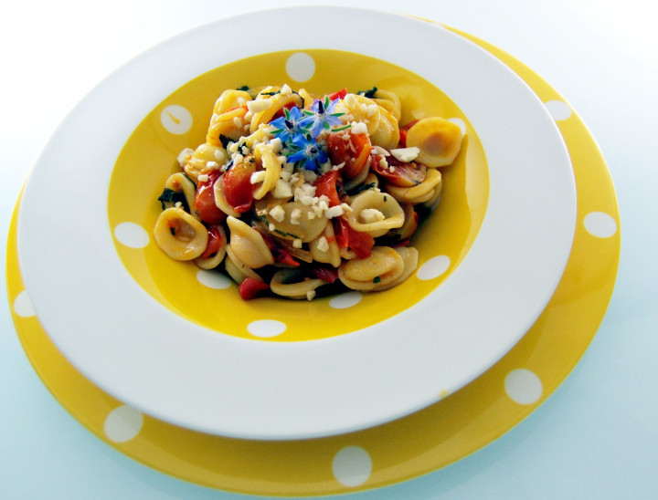 Orecchiette with tomatoes, borage and almonds
