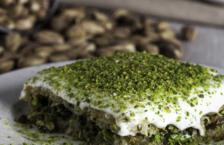 White ragu meat lasagne with mushrooms and pistachios